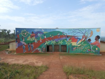 A mural dedicated to ASYV on the side of the Dining Hall/Community Center. It displays all the aspects of the beautiful village.