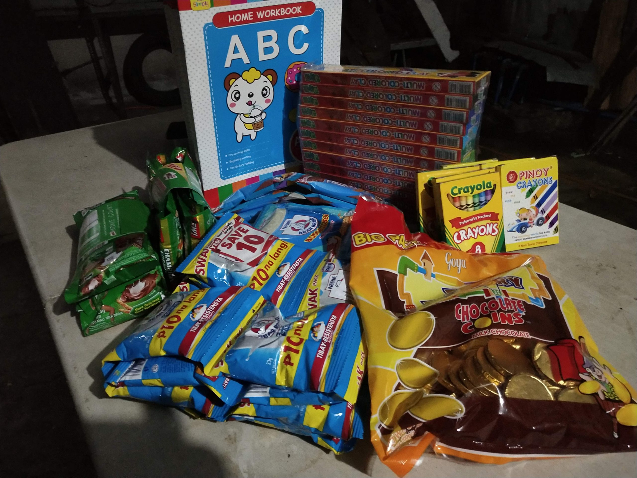 Activity books, crayons, candy, milk, and supplements for the kids