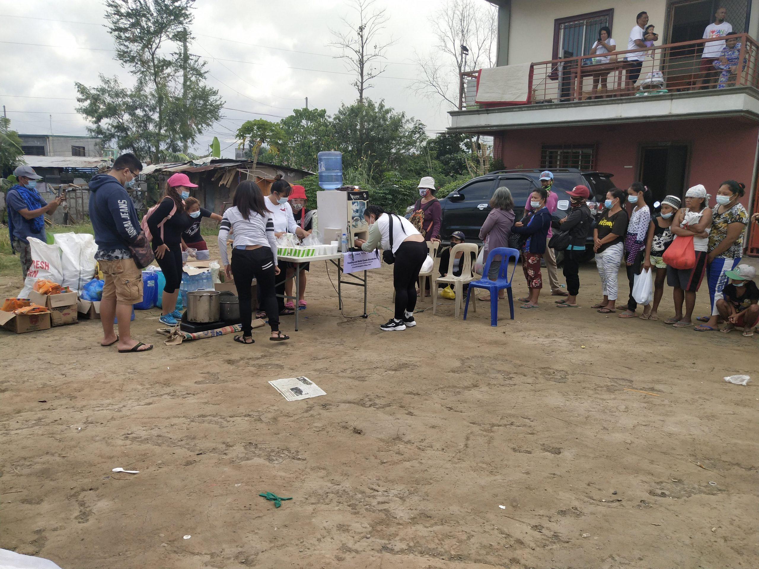 Those in line get a bowl of chicken rice porridge (Arroz Caldo) and their choice of hot coffee or hot chocolate, and water.