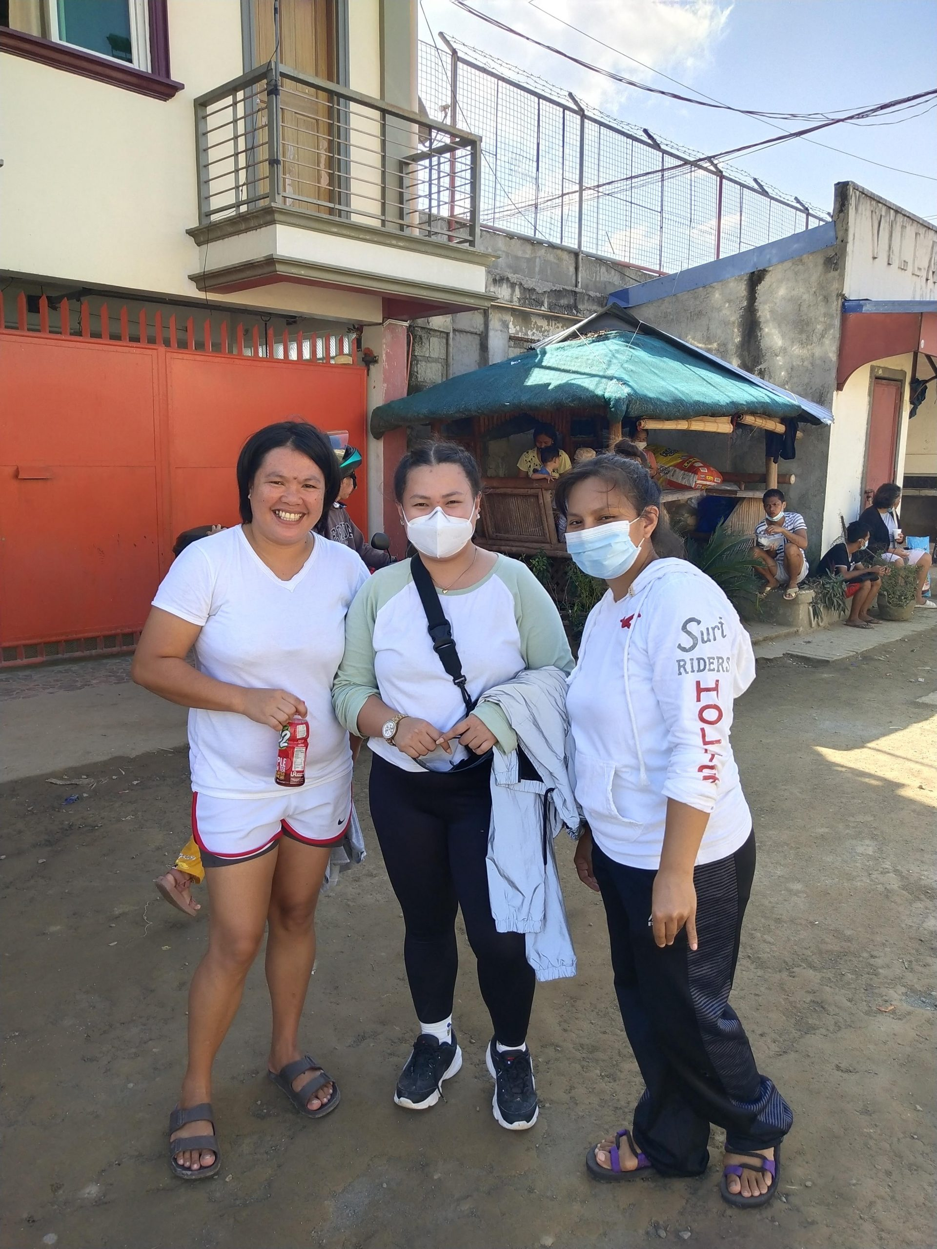 The owner of the compound, Mrs. Aiza Casanillo Tarog (left), with a couple of our volunteers
