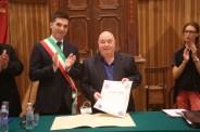 Il Sindaco Francesco Acquaroli, don Vincenzo Galiè ed il vicesindaco Noemi Tartabini. Foto di Luigi Anzalone.