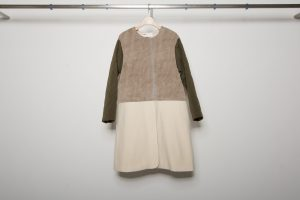 Quilting sleeve switching bore coat