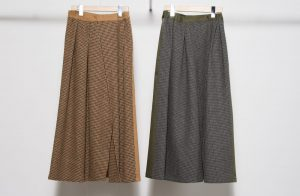 Irregular tack check switching skirt