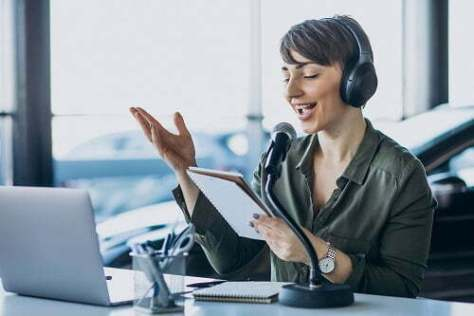 Young woman with microphone recording voice acting