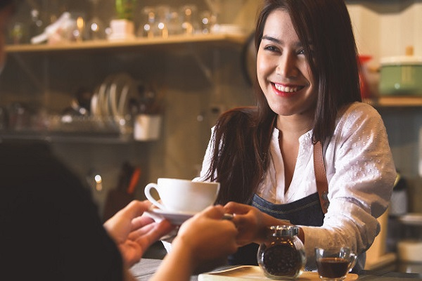 Student waitressing as a part time job while studying abroad