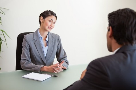 An ongoing visa interview where the student submits his f1 visa interview documents