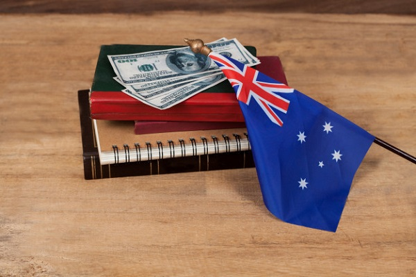 Australian flag and books for Top universities for MS in Australia