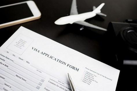 A visa application form being filled