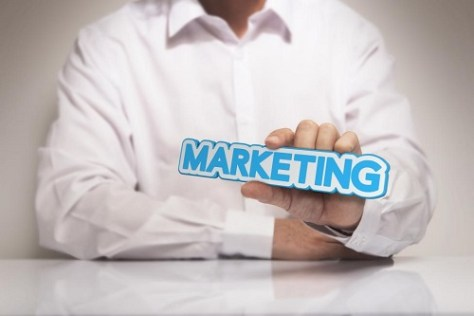 Marketing manager holding a marketing sign