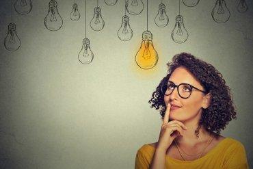 Woman thinking about IELTS vs TOEFL vs PTE