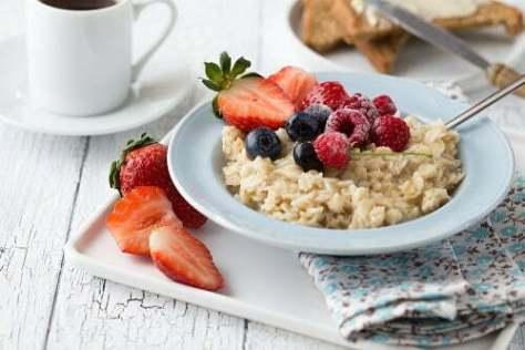 breakfast-oatmeal-porridge-with-fruits-berries-coffee-cup
