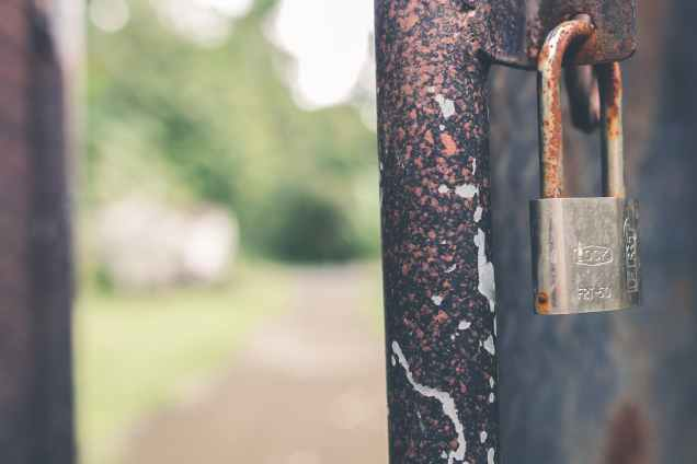 rusted grey padlock in selective focus photography