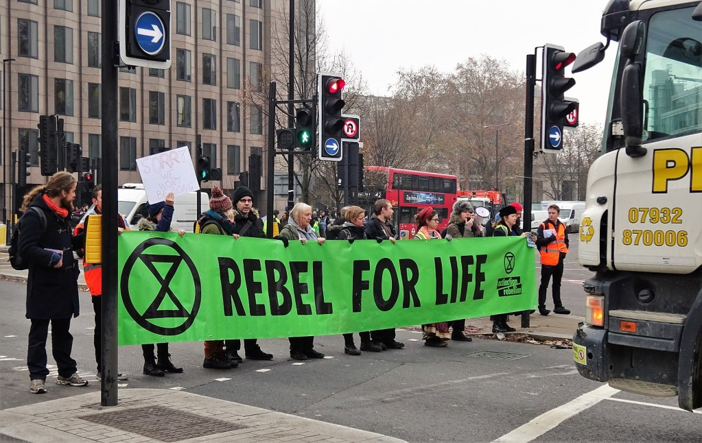 extinction rebellion protest with banner