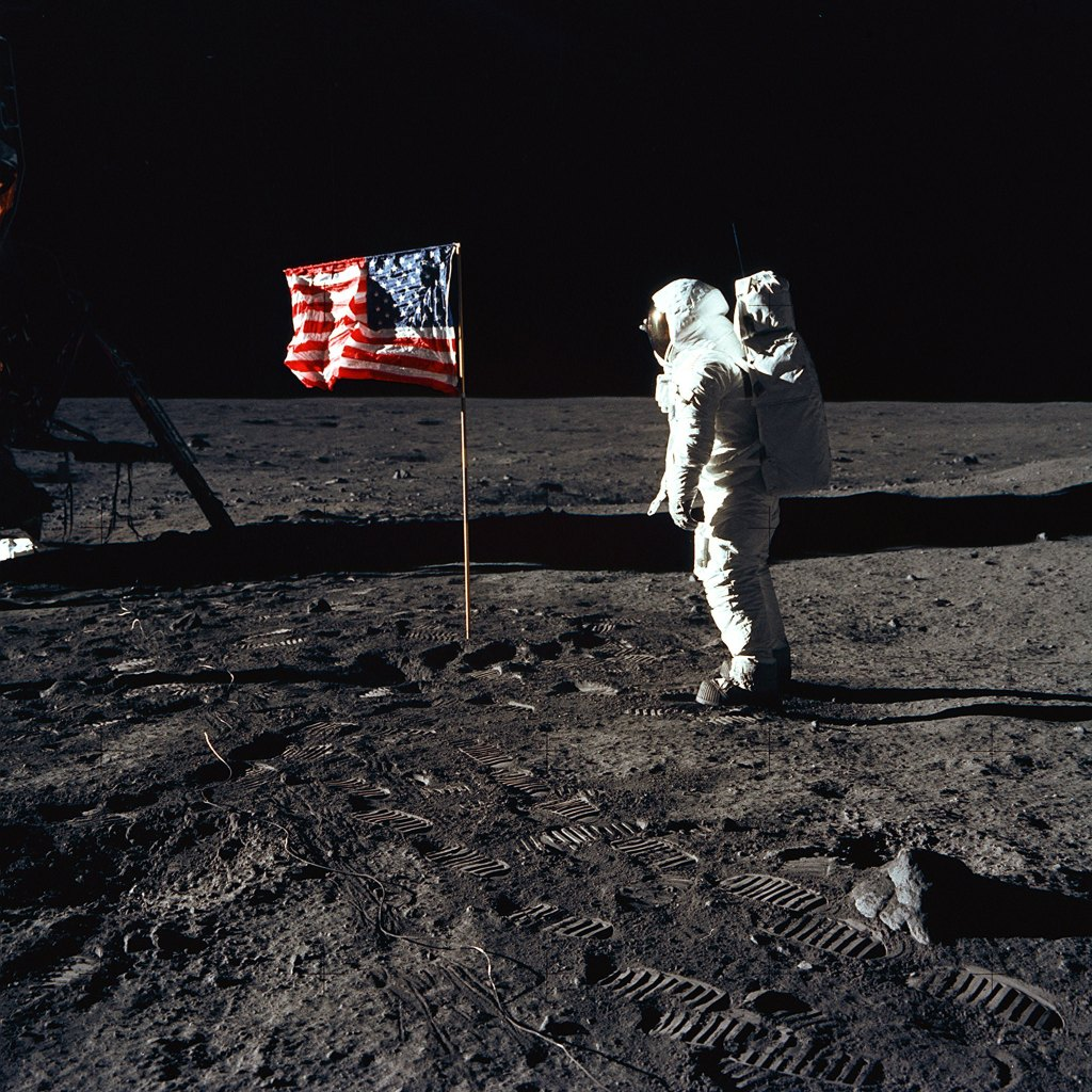 Buzz Aldrin on moon with American flag