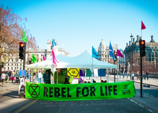 Extinction Rebellion booth and banner
