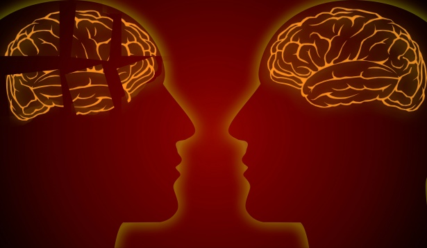 2 Brains and face silhouettes looking at one another