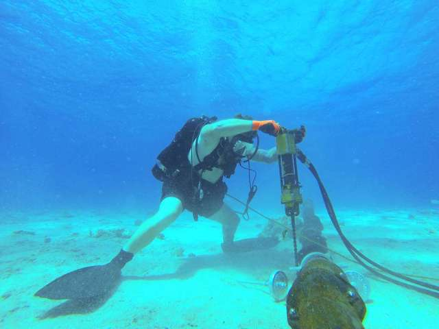 visibility Visually Similar Images found on the Internet, copyright status not evaluated. A Navy construction electrician drills to install cable stabilizers at the Kwajalein Missile Impact Scoring System Range.