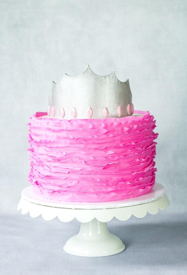 Silver Fondant Crown on top of pink fondant ruffle cake