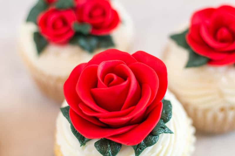 close up of large easy fondant rose on cupcake