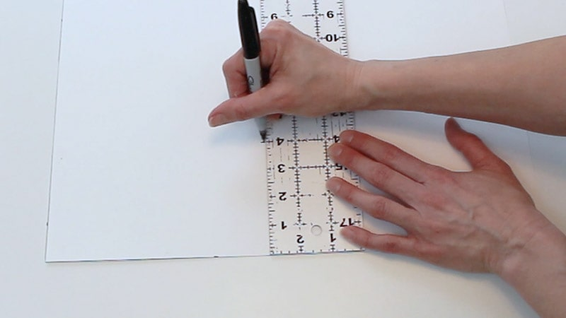 measure up 4 inches from bottom of poster board