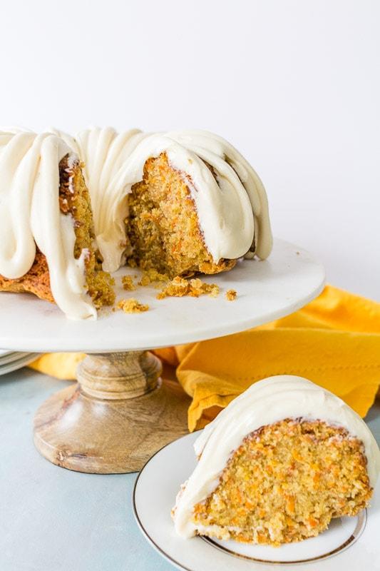 caramel carrot cake front view of sliced bundt cake