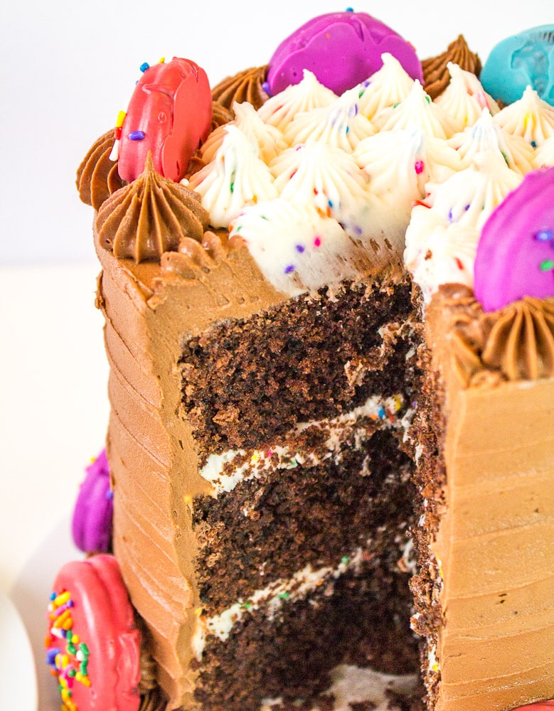 oreo insanity cake with slice cut out