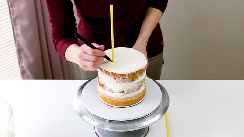 Mark the dowel at the top of the cake tier