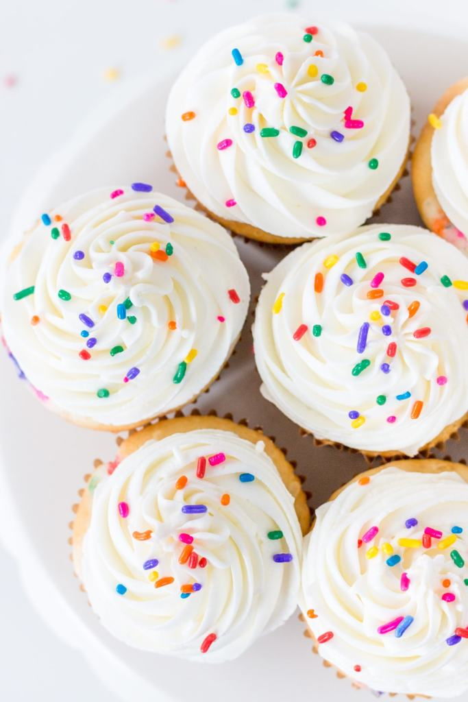 top down view of cupcakes with sprinkles on a cake stand