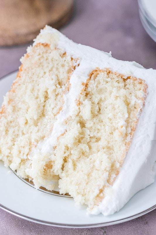 Slice of moist white cake on white plate