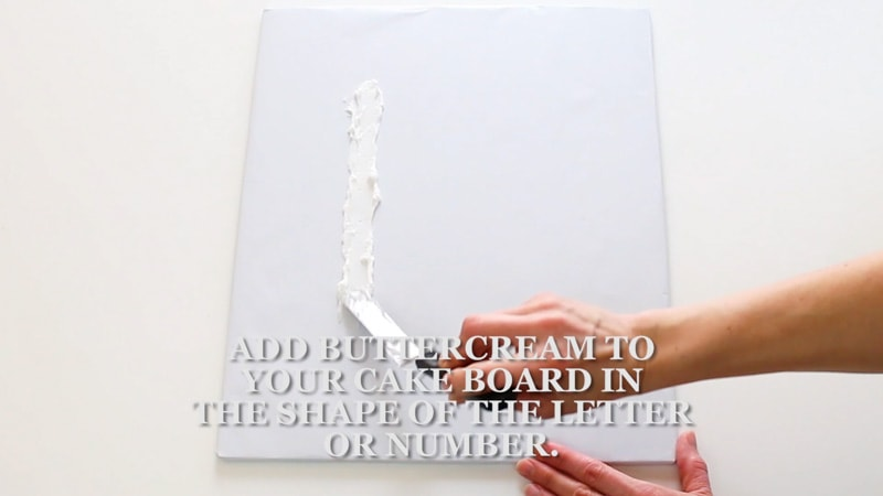 adding buttercream to the cake base
