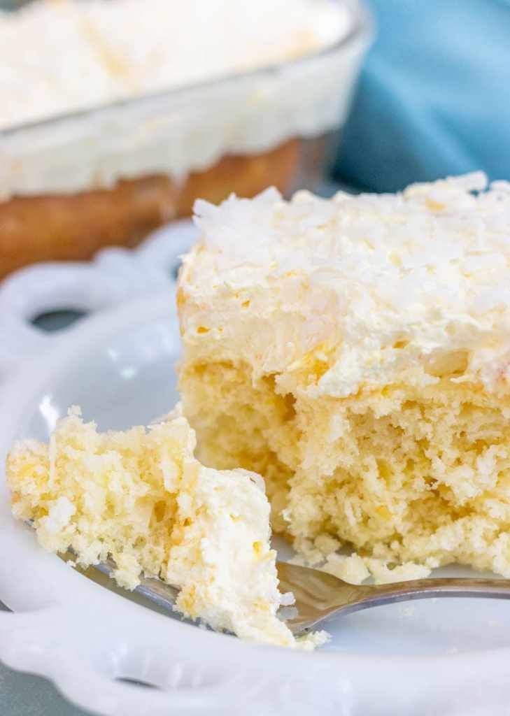 Slice of pina colada cake with a fork