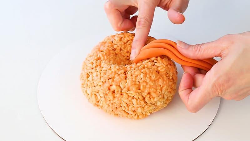 attaching fondant to pumpkin