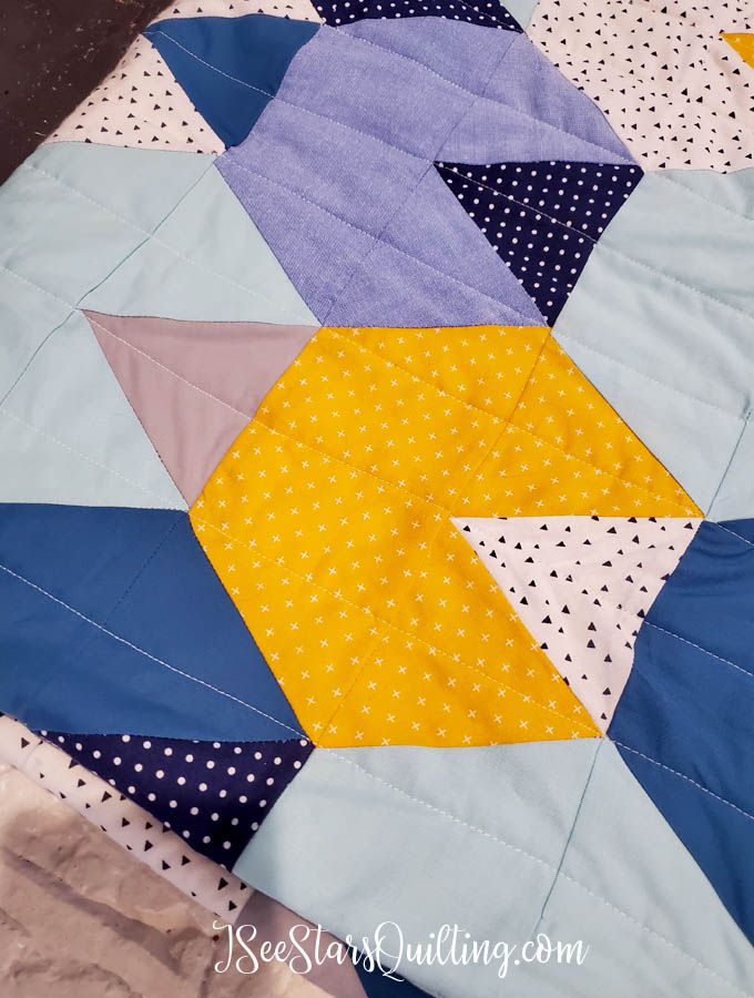 "This ""Baby Mountains"" Hexagon quilt is made using a half-hexagon and triangle template. I love the earthy vibe that it has while still having the soft fabrics for baby quilt perfection!"