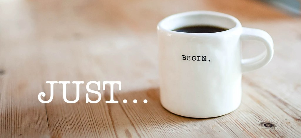 Coffee mug with the words Just... begin