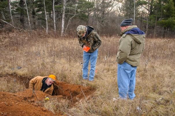 Soil specialist evaluating soil properties.