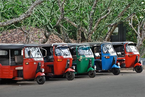 Bright coloured tuk-tuks on Srilankan roads