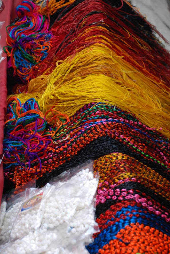 Coloured threads to wear as sacred threads on the hands after the worship