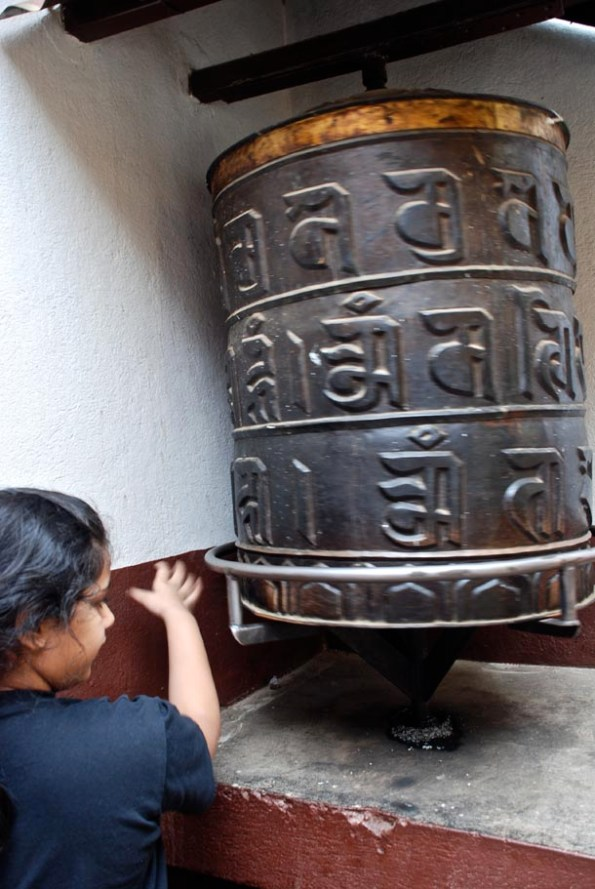 Big Z spinning a huge prayer wheel while chanting the Mantra!