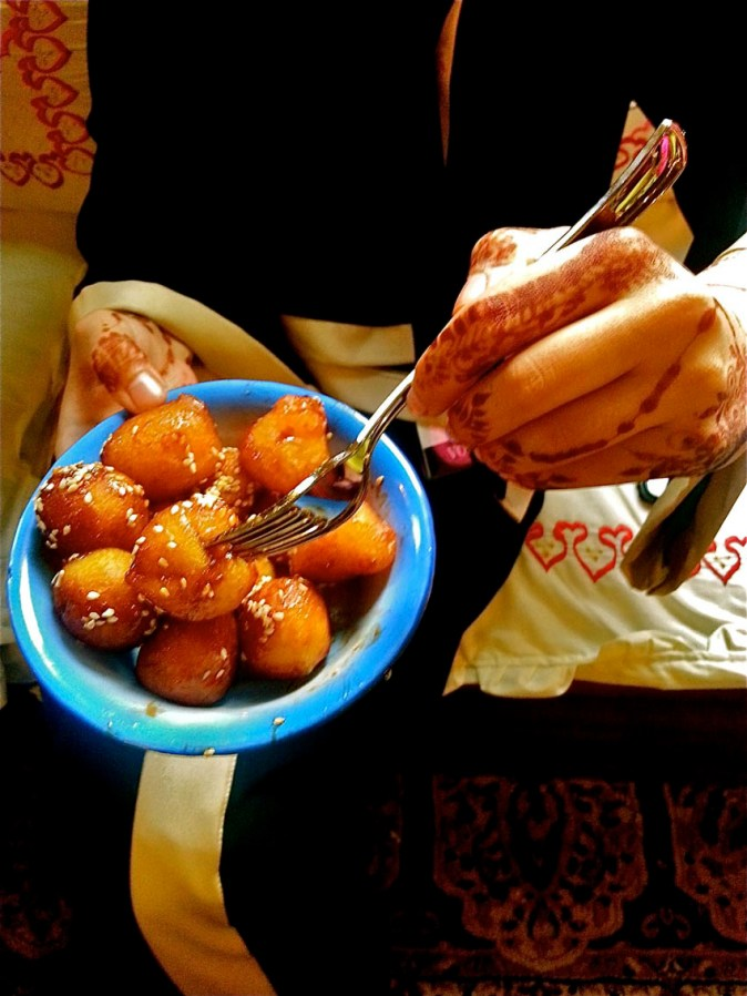 Leqaimat, crispy fried golden dough balls coated with date syrup and sesame seeds. This is one deadly-divine-dessert!