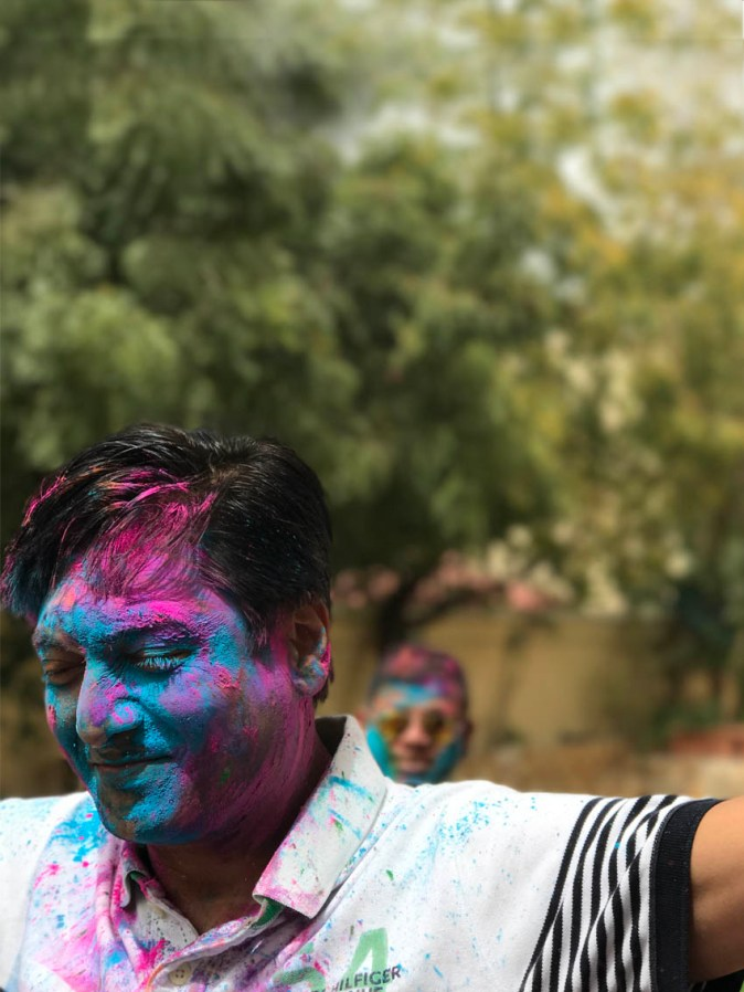 People with Holi colours on their faces