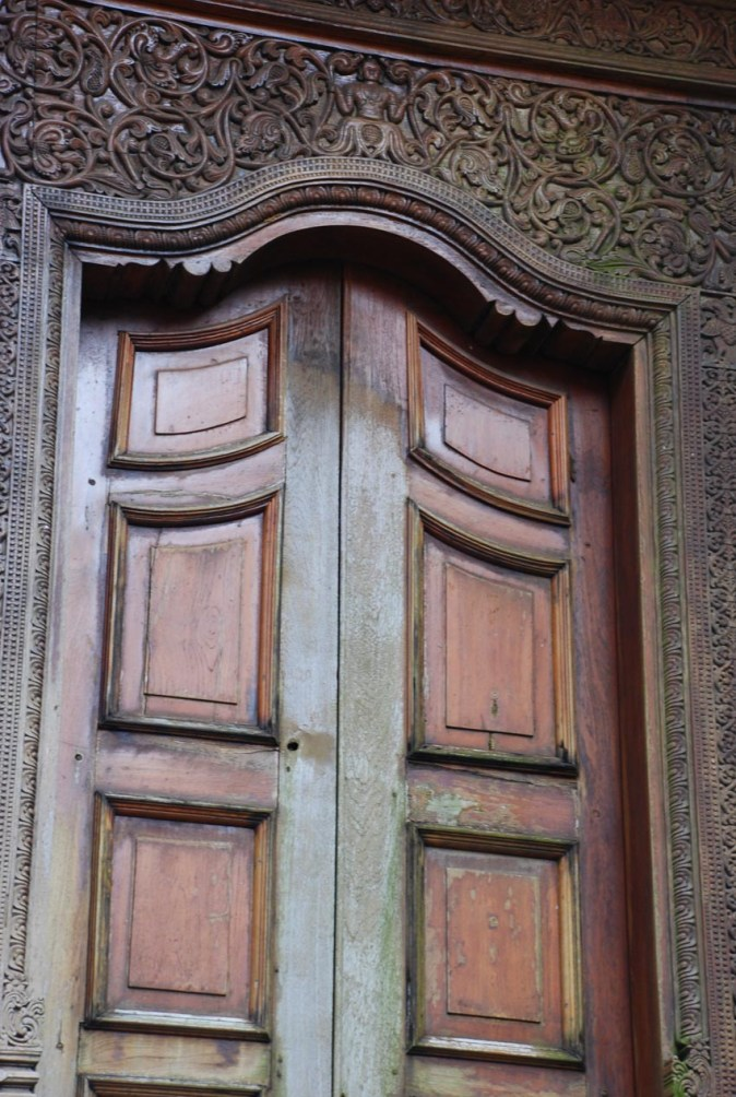 Carvings on wooden door in Temple of the Tooth Relic