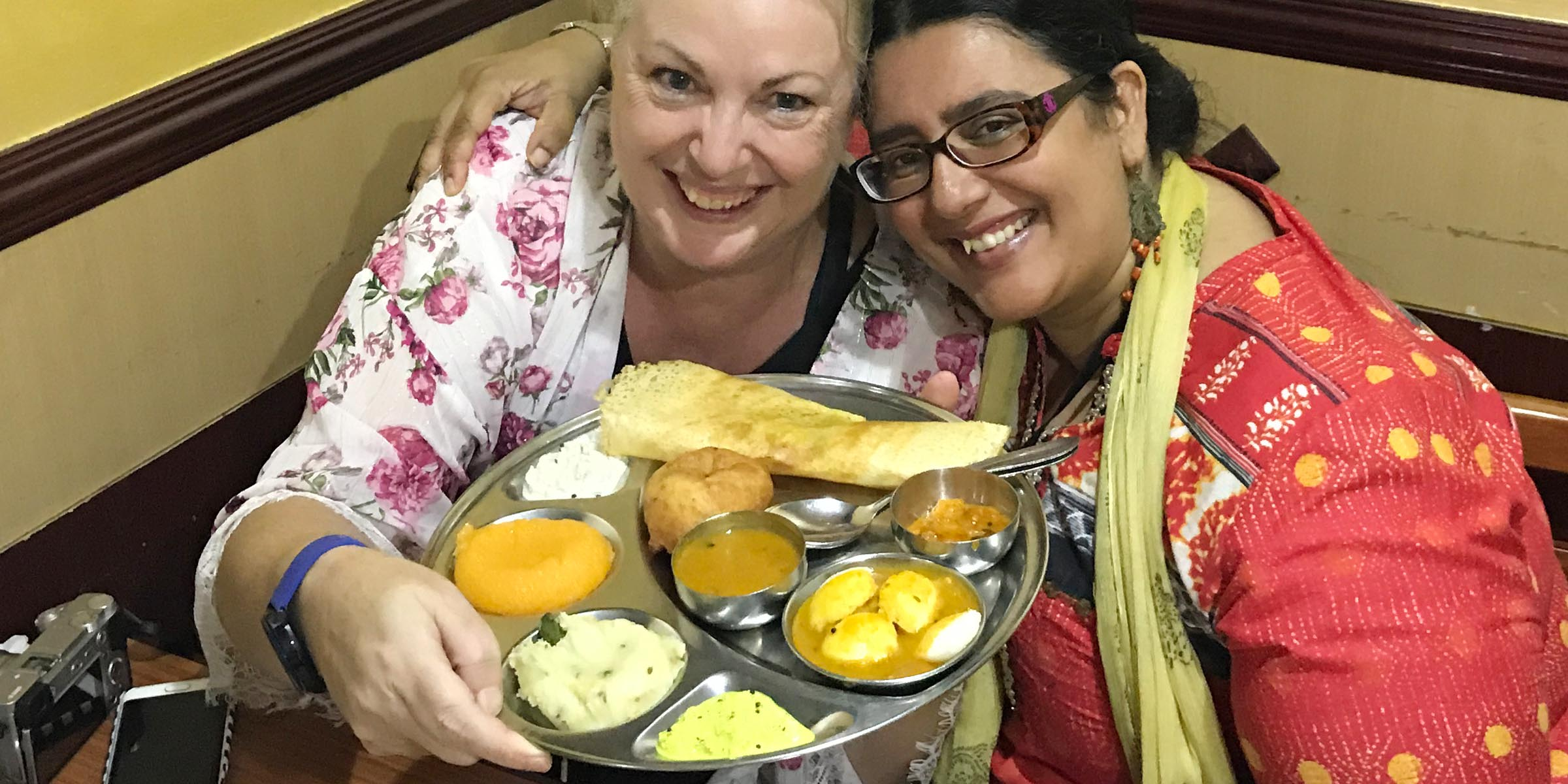Debbie Rogers and Ishita B Saha on a food tour with Frying Pan Adventures