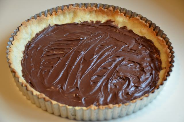 Chocolate spread over hot crust