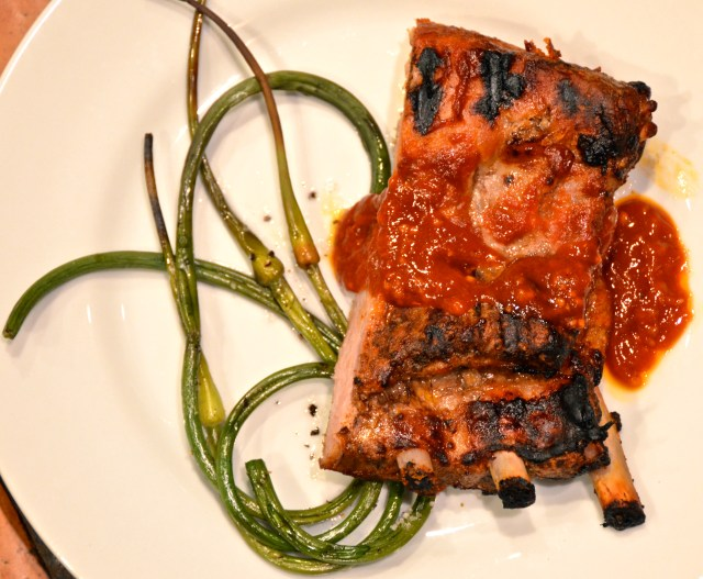 Succulent Pork Spareribs With Grilled Garlic Scapes