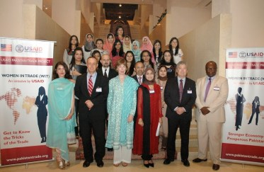 Wife of US Ambassador Cameron Munter, Dr Marilyn Wyatt  posing for a group photo with the participants.