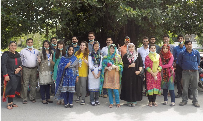 Group photo of participants  who took part in tree plantation drive held near Blue Area Islamabad