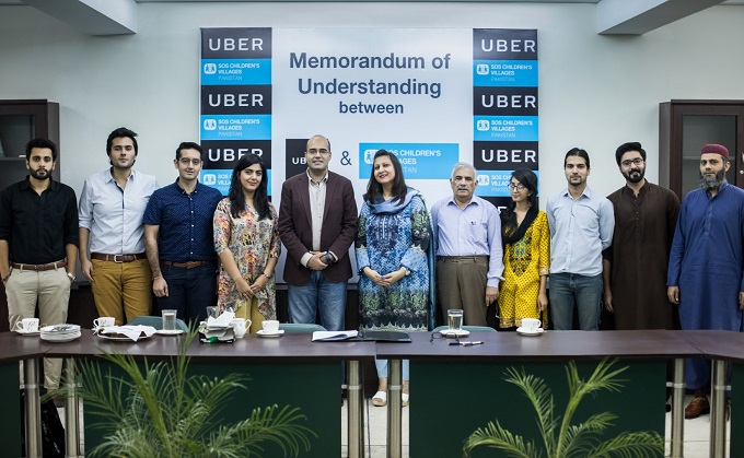 GM Uber Pakistan Safee Shah and Saba Faisal National Director SOS Village signed an MOU as part of Uber's CSR activities.
