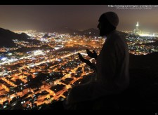 A Muslim pilgrim prays as visits the Hiraa cave at the top of Noor Mountain on the outskirts of Mecca, Saudi Arabia on November 2, 2011. According to tradition, Islam's Prophet Mohammed received his first message to preach Islam while he was praying in the cave. (