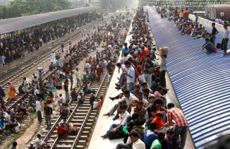 Bangladeshi passengers sit on the roof of a train as they head to their homes to celebrate Eid al-Adha on the outskirts of Dhaka, Bangladesh on November 6, 2011. (Pavel Rahman/AP) #