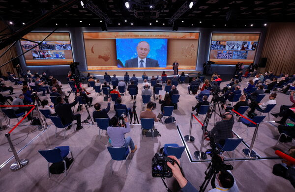 Putin laughs off a question about poising opposition leader